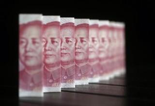 Деловые новости Китая за неделю: растущая популярность юаня и успехи iPhone в Китае