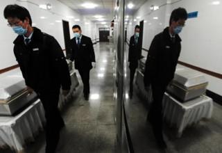 Менее половины умерших китайцев были кремированы в 2014 году