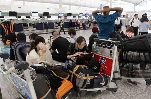 аэропорт Гонконга задержки рейсов