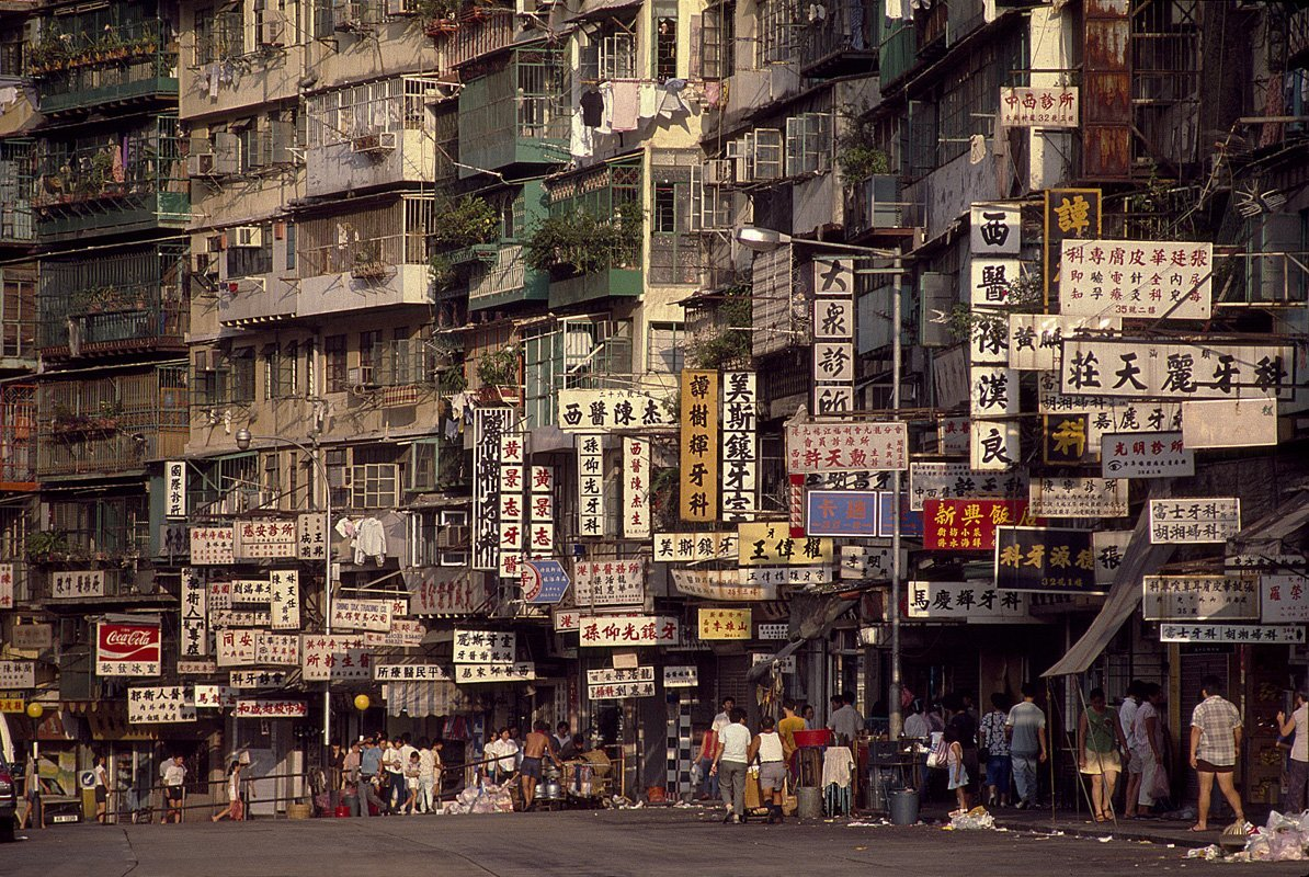 by-1986-the-walled-city-had-caught-the-attention-of-photographer-greg-girard-girard-would-spend-the-next-four-years-in-and-out-of-the-city-capturing-daily-life-inside-its-teetering-walls