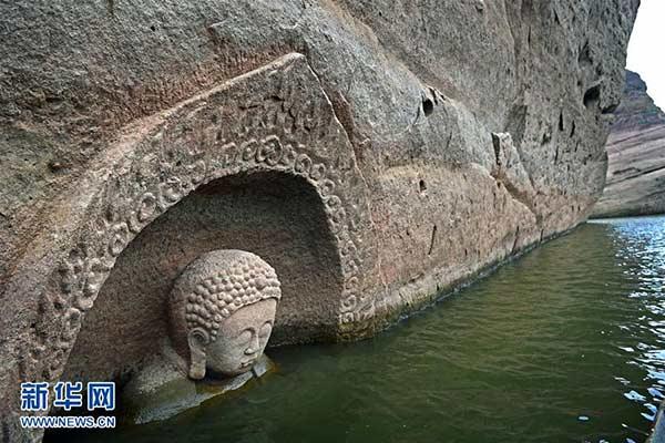 Статуя Будды, обнаруженная в водохранилище Хунмэнь в декабре прошлого года. Фото: China Daily