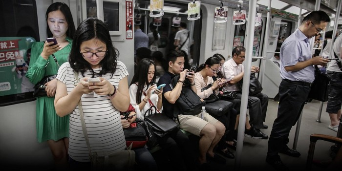Chinese use smartphones
