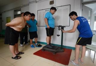 Китайские медики: китайцы толстеют и лысеют